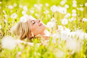 Pretty young blonde lying in the field of dandelions with her eyes closed.  [url=http://www.istockphoto.com/search/lightbox/9786750][img]http://img291.imageshack.us/img291/2613/summerc.jpg[/img][/url]